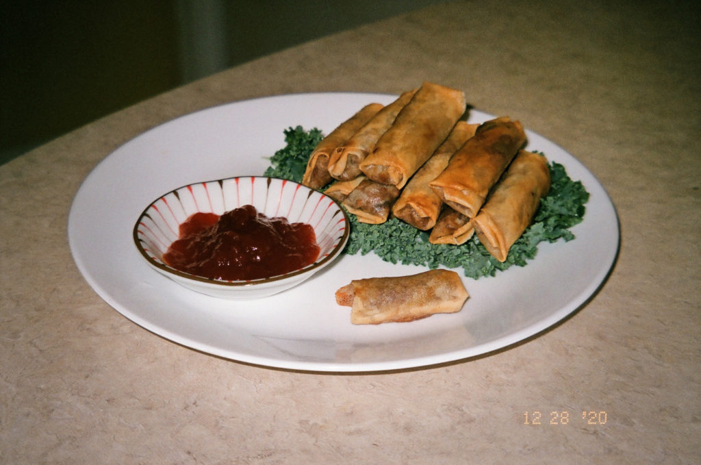 A stack of fried lumpia served with banana ketchup